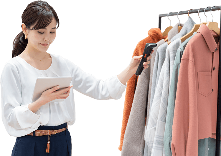 Woman scanning clothing with handheld scanner