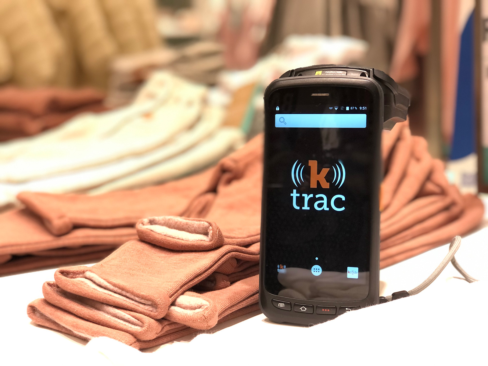 ktrac scanner sitting in front of folded clothing